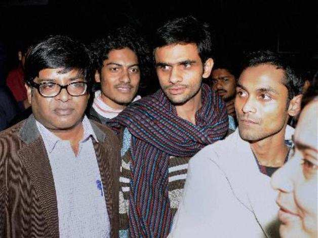 New Delhi: Jawaharlal Nehru University students Umar Khalid (C) and Anirban Bhat...