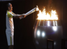 Brazilian marathoner Vanderlei de Lima lights Olympic torch