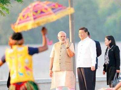 चीनी राष्ट्रपति के साथ पीएम मोदी (फाइल फोटो)।