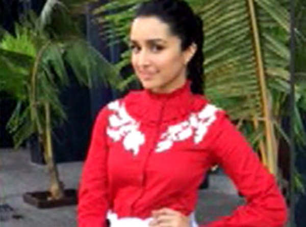 check out shraddha kapoor in a red turtleneck shirt