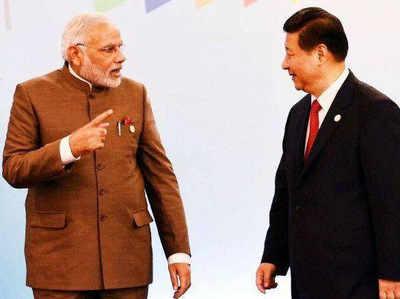 चीनी राष्ट्रपति शी चिनफिंग के साथ नरेंद्र मोदी (फाइल फोटो)