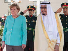 saudi arabias king salman welcomes german chancellor angela merkel who arrives without headscarf