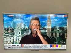 author eats books on national television over britain elections