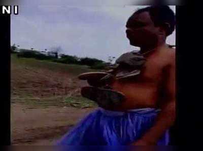 महिला से छेड़खानी के आरोप में शख्स का सिर मुंड़ा घुमाया
