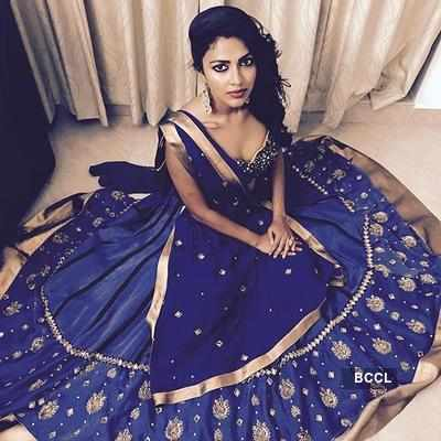 Amala Paul poses in a blue designer dress