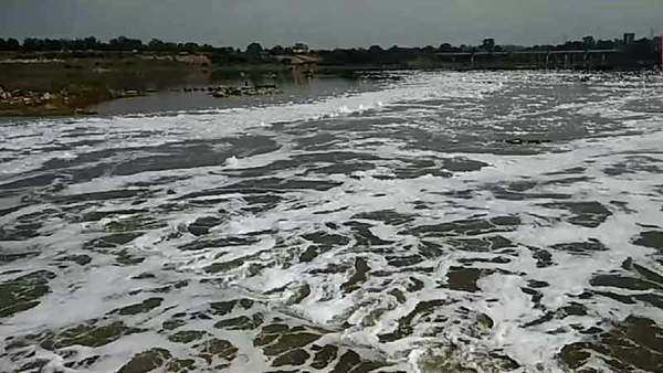 froth covers gomti river as drains pour in sludge