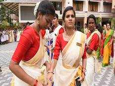 onam celebrations girls wearing traditional kerala saree participate in tug of war
