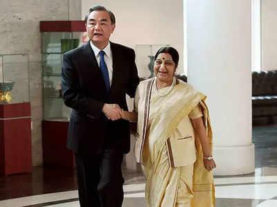 वांग यी के साथ सुषमा स्वराज