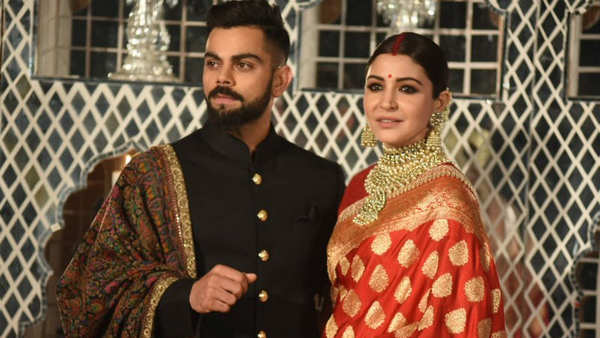 Watch Anushka Sharma Virat Kohli pose for media at their reception in Delhi