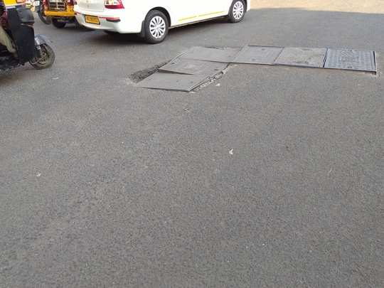 Crooked Manhole cover in Marol Road Junction