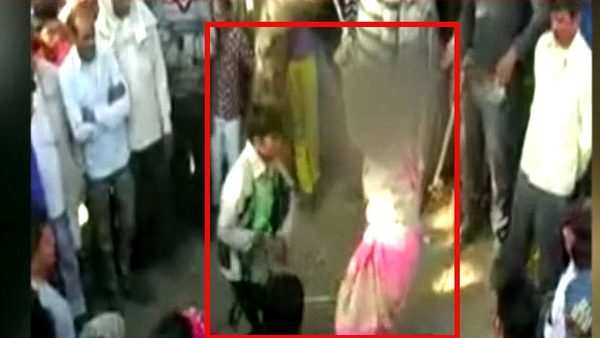 shocking man thrashes wife in public following panchayats diktat
