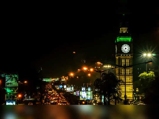 me9037808-times-lapse-night-time-traffic-city-kolkata-iconic-clock-india-hd-a0200-poster