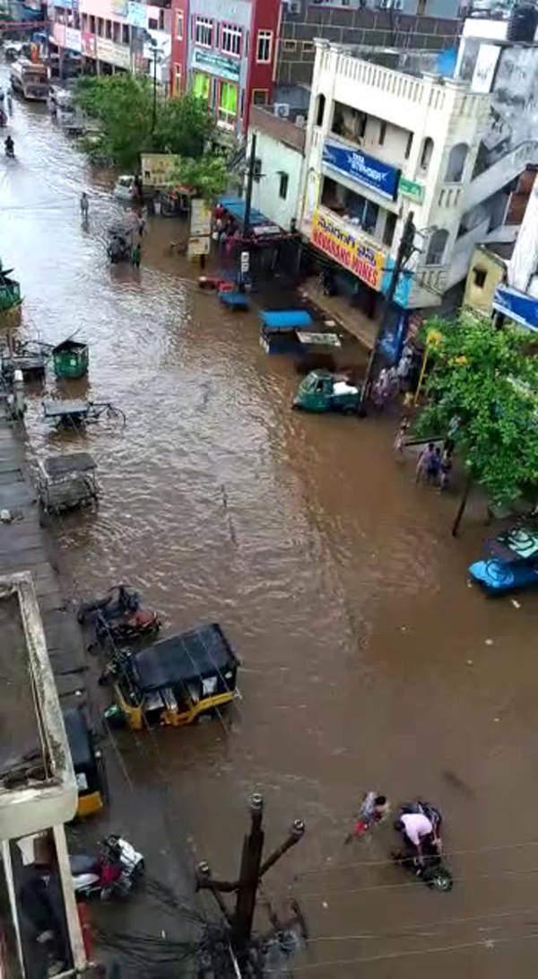 watch heavy rain creates havoc in vijayawada