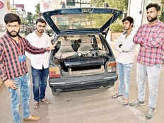 engineering students modified cars which will be run on limestone and water in nagpur