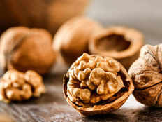 research finds walnuts may promote health by changing gut bacteria