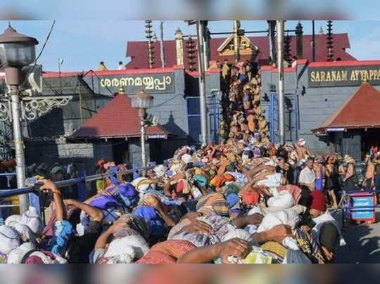 **FILE** Sabarimala: In this file photo dated Nov 18, 2013, devotees wait at Lor...