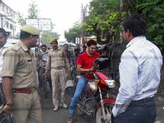 varanasi dm hand over biker to police for riding bike without helmets