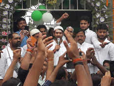 an armed man clutches hand of tej pratap yadav he said this is conspiracy of rss and bjp