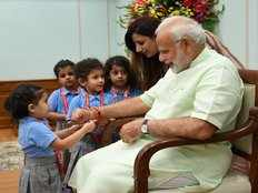 school kids celebrate raksha bandhan by tying rakhi on pm modis hand