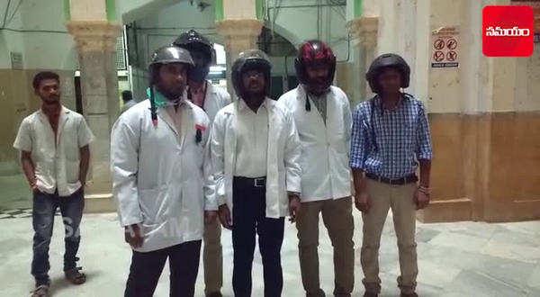watch osmania hospital staff wear helmets to protect