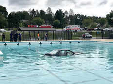 driving lesson gone wrong in america when car drove into swimming pool