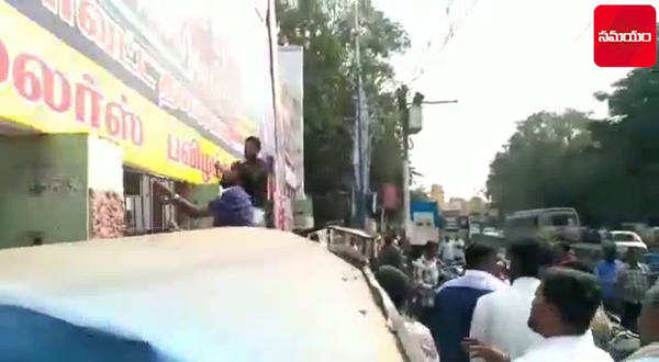 watch aiadmk cadres protest against sarkar film across tamil nadu