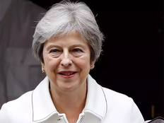may says deferring tuesdays vote on brexit deal