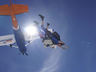 a 102 year old woman has completed a world record charity skydive