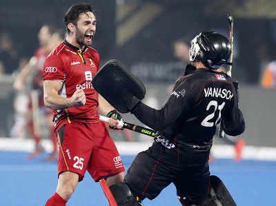 मैच जीतने के बाद जश्न मनाते बेल्जियम के खिलाड़ी।