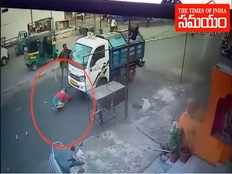 surat woman escaped miraculously as minivan runs over her