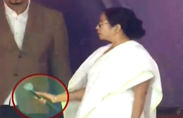 mamata banerjee loses cool at media walks off stage after throwing down mic