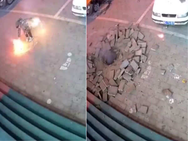 chinese boy throws a firecracker down a manhole and blows up the sidewalk watch video