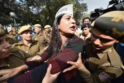 Police detain AAP leader Alka Lamba during a outside Home Minister Rajnath Singh's residence in New Delhi on Thursday.Photo by Arun Sharma