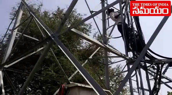 watch girl climbs cell tower to commit suicide over love affair in warangal