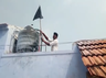 black flag protest conducted against high voltage towers in farmland near erode