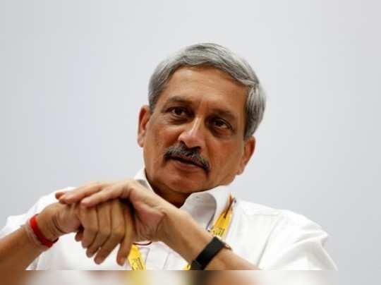 Indias Defence Minister Manohar Parrikar attends a seminar during the Vibrant Gujarat investor summit in Gandhinagar