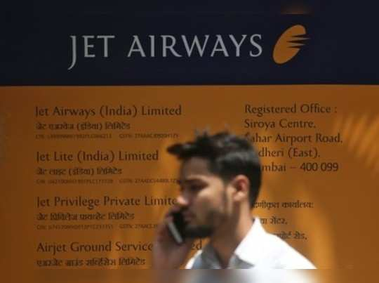A man speaks on the phone outside the Jet Airways headquarters in Mumbai