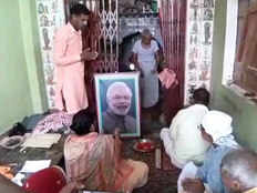 putting a picture of narendra modi at the temple 9 day fast and performed puja for his second term as the pm