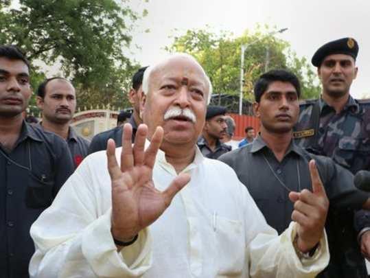 Nagpur: Rashtriya Swayamsevak Sangh Chief Mohan Bhagwat shows his finger marked ...