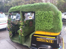 green auto running on the streets of pune people say if the snake enters then