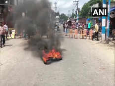 local traders block roads burn tyres in siliguri in protest of cut money