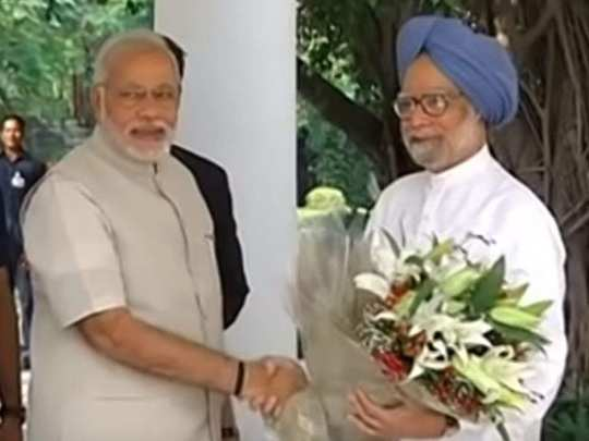 Narendra Modi with Manmohan Singh