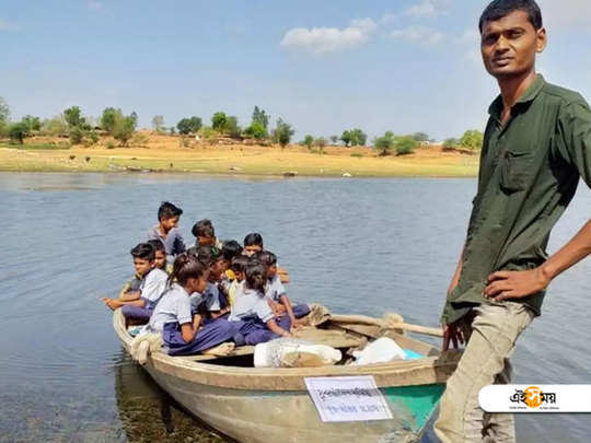 students of an island located in the panam reservoir in gujrat use boats to reach school