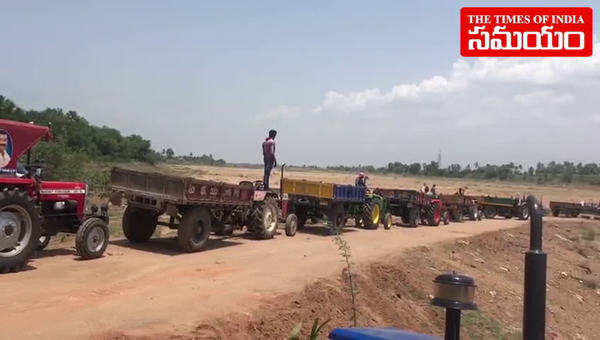 watch tractors in queue for sand at krishna river in ap