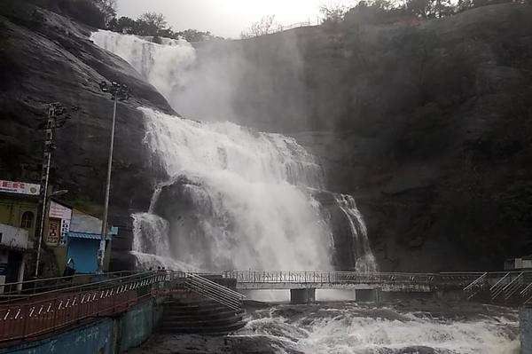 heavy flow in courtallam falls visitors upset over ban on bathing