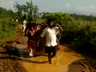 pregnant woman carried on a makeshift stretcher due to lack of road connectivity