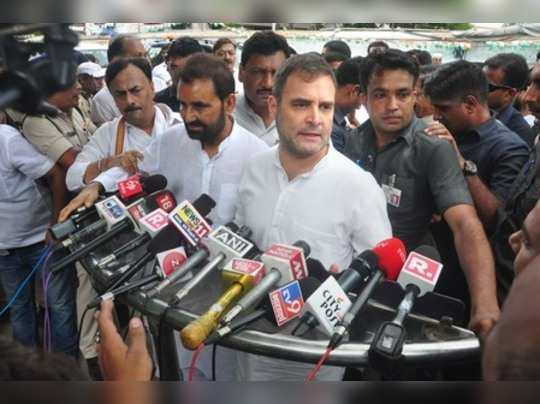 Patna: Congress leader Rahul Gandhi speaks to media after appearing in civil cou...