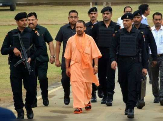 Varanasi: Uttar Pradesh Chief Minister Yogi Adityanath arrives in Varanasi. (PTI...