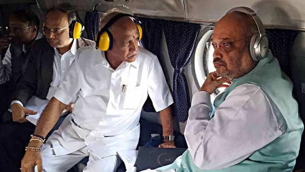 amit shah cm yeddyurappa conduct aerial survey of flood affected areas in karnataka