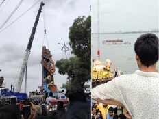 devotees fall down into hussain sagar water as barricades break down on tank bund